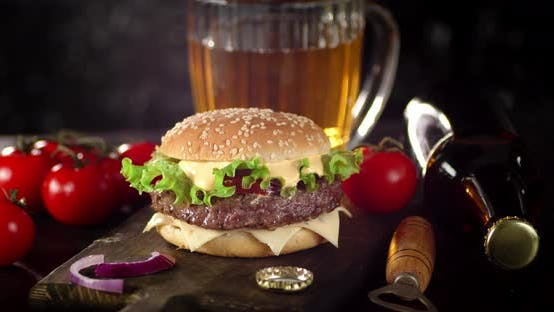 Thumbnail for A Burger with a Beer Is Slowly Rotating on the Table.