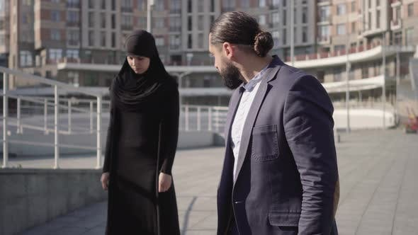 Thumbnail for Middle Shot of Furious Middle Eastern Man Looking at Stressed Muslim Woman in Hijab