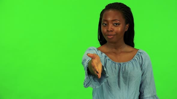 Thumbnail for A Young Black Woman Extends Her Arm To the Camera for a Handshake - Green Screen
