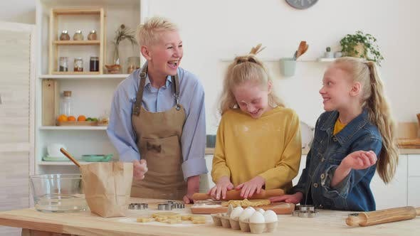 Thumbnail for Girls and Grandma Playing with Flour