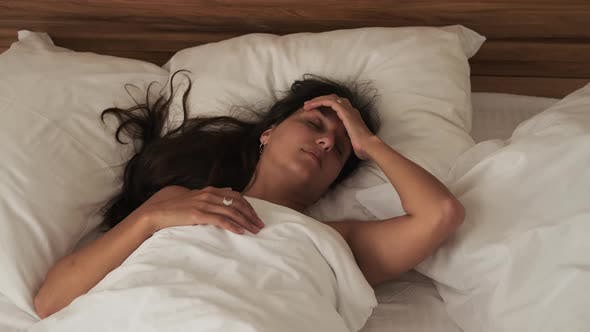 Morning After Party Woman is Waking Up Alone in Hotel Room