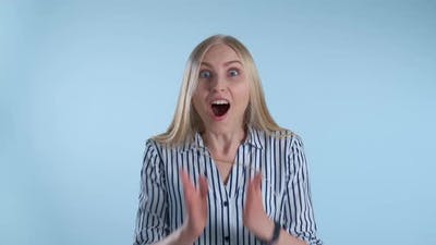 Blonde Female Widely Opening Her Mouth in Astonishment