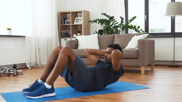 Cover Image for Indian Man Making Abdominal Exercises at Home