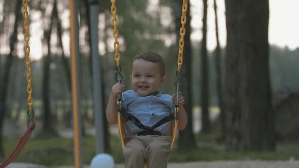 Thumbnail for Happy Baby Rides on a Swing in Slow Motion