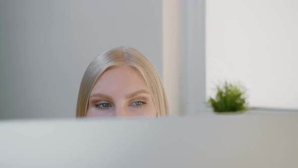 Thumbnail for Female Looking at Computer Monitor. Blond Attractive Woman Sitting at Window and Looking Attentively