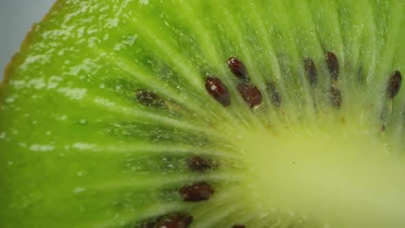 Thumbnail for Macro view of sliced kiwi slowly rotating