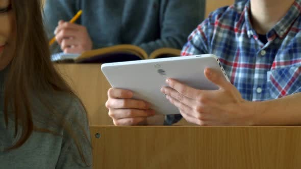 Thumbnail for Male Student Shows His Classmate Something on Tablet