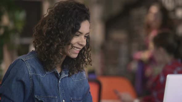 Cover Image for Beautiful Mixed Race Woman Making Video Call on Laptop, Modern Technologies