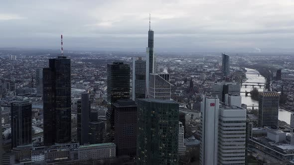 Thumbnail for AERIAL: Wide Shot of Frankfurt Am Main, Germany Skyline on Cloudy Grey Winter Day