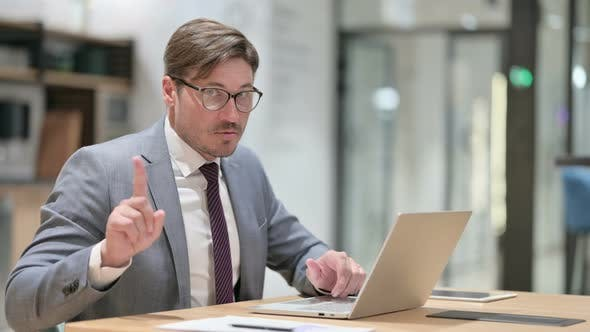 Thumbnail for Serious Businessman with Laptop Saying No with Finger Sign