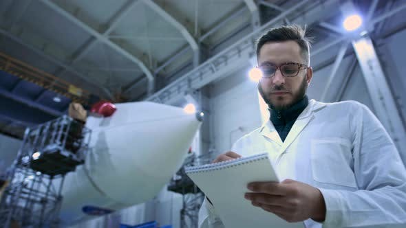 Industry Concept Man Engineer in Modern Hangar of Space and Aviation Transport
