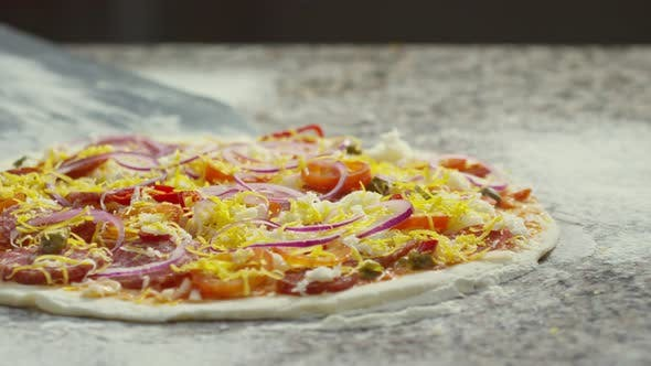 Chef Taking Pizza with Peel