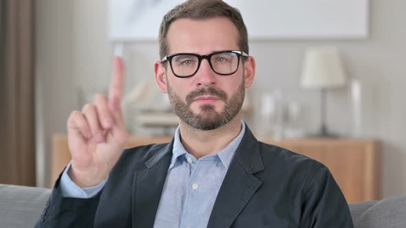 Thumbnail for Portrait of Young Businessman Shaking Finger As No Sign