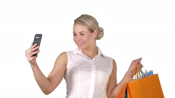Thumbnail for Sale, Consumerism, Technology and People Concept - Happy Young Woman with Smartphone and Shopping