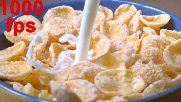 Thumbnail for Milk Pouring Into Cereal Corn Flakes