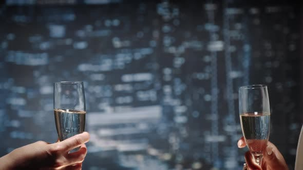 Thumbnail for Close Up of Two Hands with Bocals of Champagne Making Cheers and Then Drinking