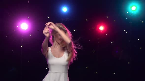 Thumbnail for Carefree Girl Are Dancing Against Disco Lights. Slow Motion
