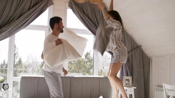 Thumbnail for Happy Couple Jumping on Bed in Morning