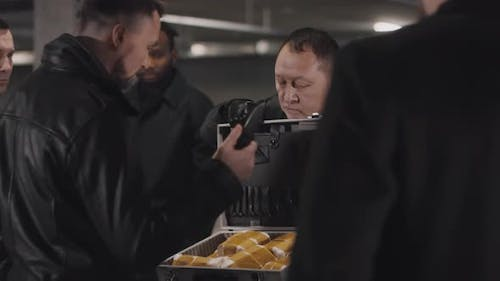 Criminals Checking Forbidden Items From Briefcase