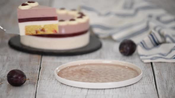 Thumbnail for Piece of delicious mousse cake with whipped cream and plum jelly