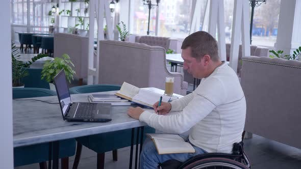 Thumbnail for Distance Education of Invalid, Successful Sick Student Male on Wheelchair Working with Laptop To