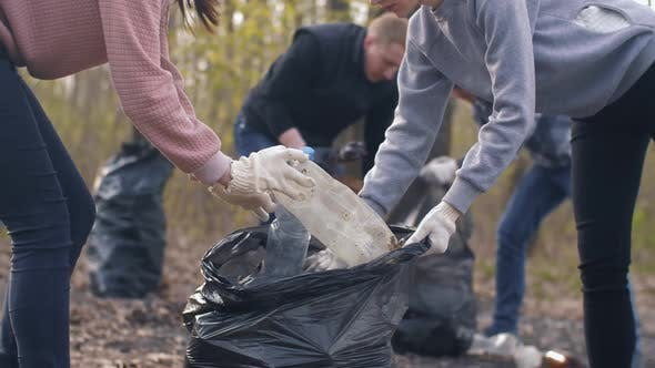 Thumbnail for Women Putting Plastic Trash in a Bag