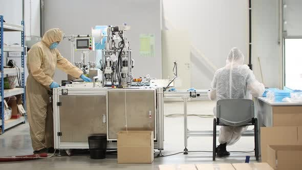 Thumbnail for Industrial Production of Medical Masks - The Machine Produces Medical Masks and Staff Working with