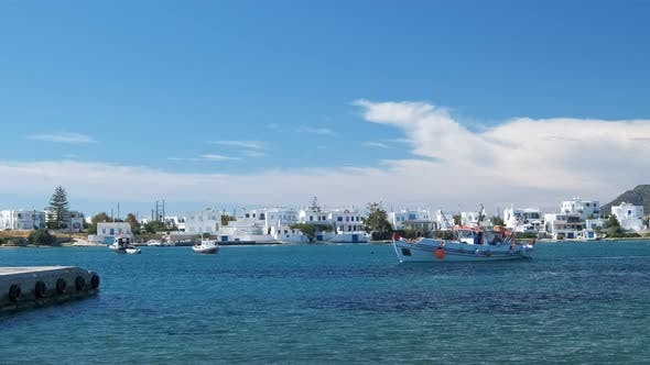 Fisherman Boat Arrive at Pier in Milos Island, Greece on Sunny Day