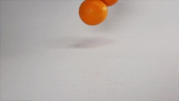 Thumbnail for Oranges Falling and Bouncing on White Wet Surface