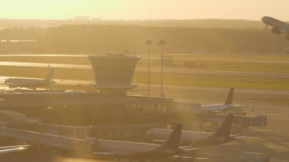 Thumbnail for Airport View in Warm Light of Sunset