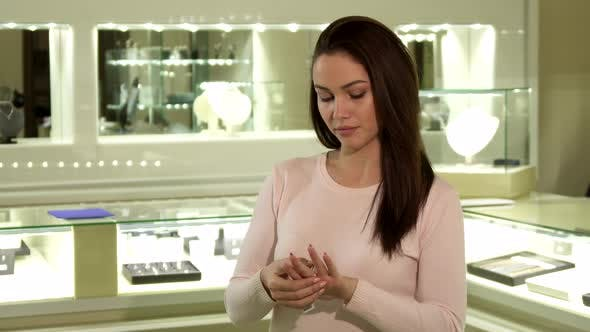 Woman Tries on the Ring at the Jewelry Boutique