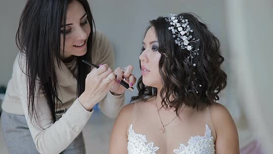 Bride Paint Makeup Artist  Makeup Artist Doing Makeup for the Bride