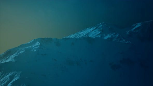 Thumbnail for Dramatic Dark Rocky Mountain with Patches of Snow in Storm