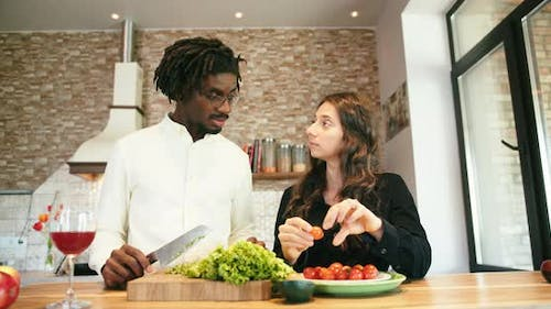 Young Couple Cut Vegetables Cook Together in Kitchen