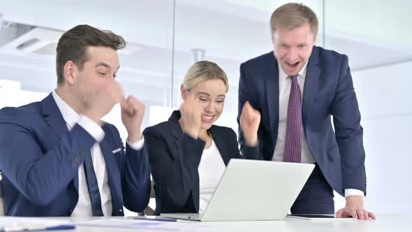 Thumbnail for Cheerful Business Team Celebrating Success on Laptop