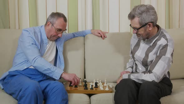 Thumbnail for Senior Retiree Playing Play Chesswith Fellow in Home.