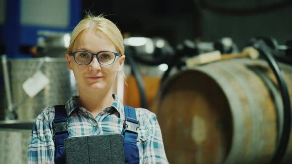 Cover Image for Portrait of a Woman Worker in a Winery