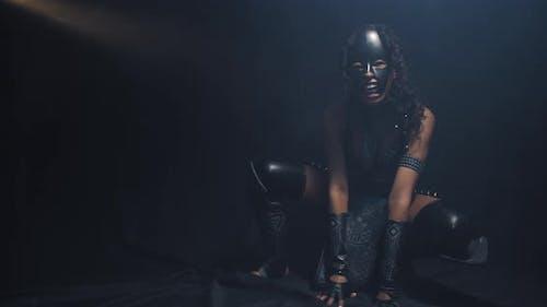 Cat Woman Cosplay Beautiful Black Woman Is Posing in the Smoke Squatting