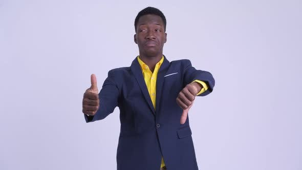 Thumbnail for Young Confused African Businessman Choosing Between Thumbs Up and Thumbs Down