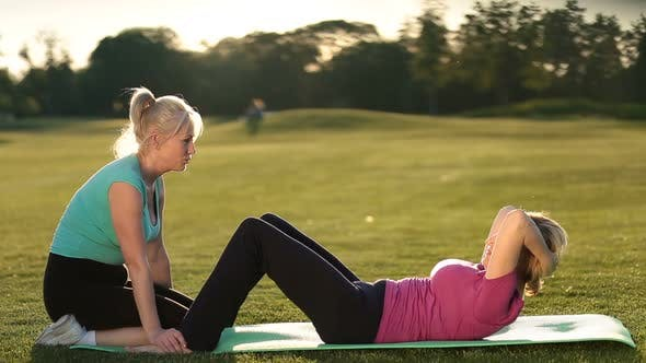 Thumbnail for Lady Doing Abdominal Crunches Exercise on Mat