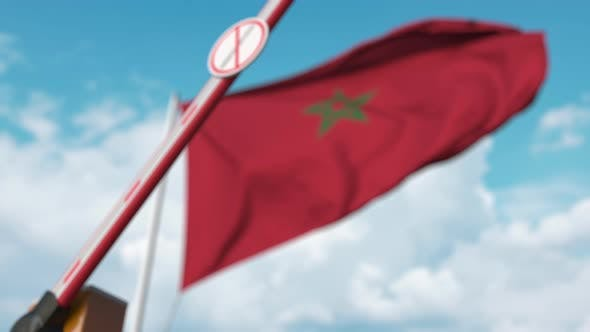 Closing Barrier with Stop Immigration Sign at the Moroccan Flag