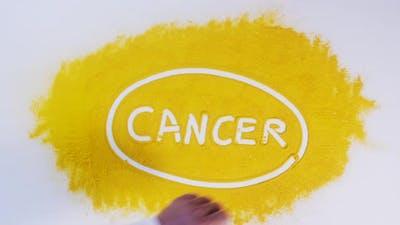 Hand Writes On Turmeric Cancer