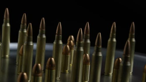 Cinematic rotating shot of bullets on a metallic surface - BULLETS 074