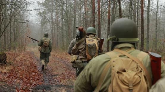 Historical Re-enactment. Re-enactors Dressed As American Soldiers Of USA Infantry Of World War II