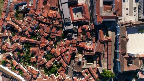 Thumbnail for Aerial view of building rooftops in a city