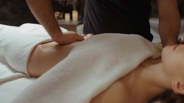 Thumbnail for Masseur Hands Burn Fat by Anti-Cellulite Massage Woman Receiving Stomach Massage at Spa Center