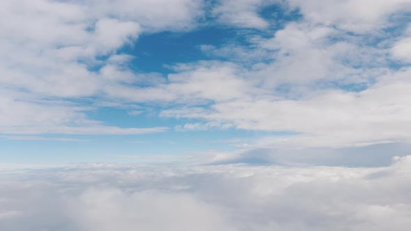 Thumbnail for View From the Window of the Plane To the Clouds and Blue Sky