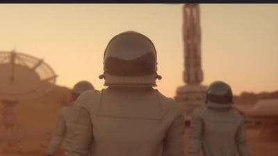Three Astronauts in Space Suits Confidently Walking on Mars