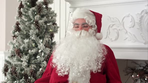 Cover Image for Tired Santa Claus Waking Up From a Nap To Continue Preparing Xmas Presents