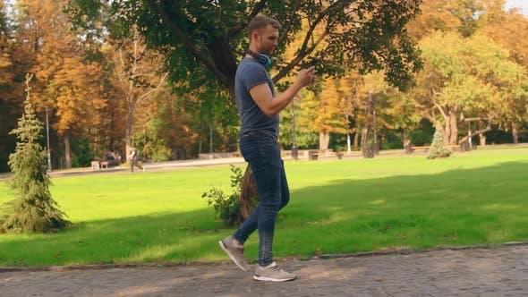 Thumbnail for Guy Using Walks in City Park